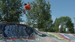 Skater catches massive air off quarter pipe and grabs rail. Stock Footage
