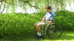 handicap man using ipad outside - stock footage
