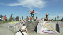 Skateboarder ollies over stairs and railing. Stock Footage