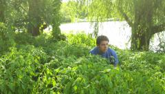 hidding in bushes head pop out - stock footage