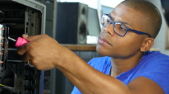 Technician repairing a computer in the office Stock Footage