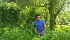 Hidding in bushes Stock Footage