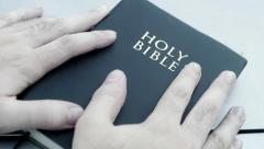 Holding bible book in hand Stock Footage