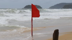 Waving red flag means it is forbid to swim - stock footage