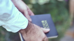 Hold bible up outside christian christianity Stock Footage