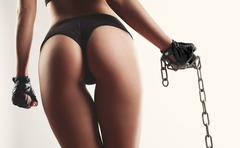 woman beautiful buttocks with chain in hand over white background - stock photo