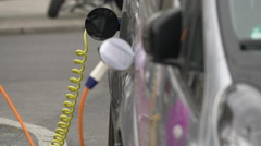 An electric charging station cable connected to a car in Berlin Stock Footage
