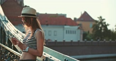 Woman using smartphone in the European city. Slow Motion. Travel. Stock Footage