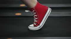 Close up woman's legs in red sneakers on a treadmill in the gym Stock Footage