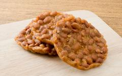 Delicious Peanut Crackers Made By Peanut or Groundnut on A Cutting Board, Tha Stock Photos