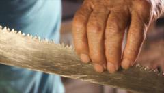 Carpenter checks his working tool. Stock Footage