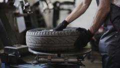 Tire service: Removing the tire from the disk Stock Footage