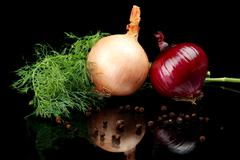 Onion,red onion,dill,pepper and allspice isolated on black background Stock Photos