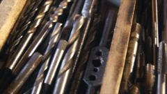 Many drill bits in wooden box. - stock footage