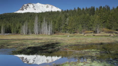 Lassen Peak and Hat Lake, Northern California (pan) Stock Footage