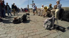 Street musicians, band plays on the Charles Bridge in Prague. Stock Footage