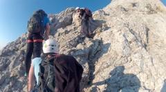Climbing towards the summit of Triglav summit on Julian Alps mountain range Stock Footage