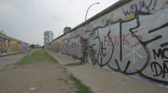 Graffiti art on Berlin Wall - stock footage