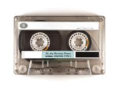 Retro audio cassette isolated on white - stock photo