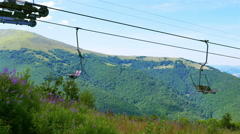 Ski elevator  rope  in summer day   up to mountain. 4K 3840x2160. Panorama Stock Footage