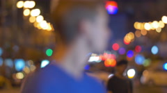 7 in 1 video! Man hold phone and call by anonymous crowd streem, bright lights Stock Footage