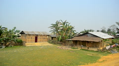 Wide shot of house, home of agriculturists of Assam Stock Footage