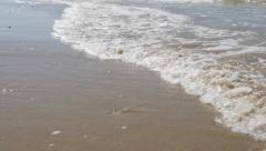Waves on sandy beach slow spreading in slow motion 1080p FullHD footage - Slo - stock footage