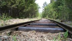 Old abandoned railroad in the forest - stock footage