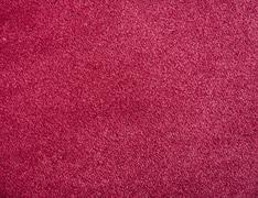 Background of red soft carpet - stock photo