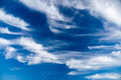 Deep blue sky with picturesque stratus clouds - stock photo