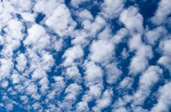 Cirrocumulus clouds against blue sky Stock Photos