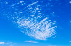 Cirrus clouds spreading on blue sky Stock Photos