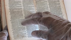 Read a book with gloves - 4k Stock Footage