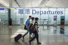 Travellers at the departure hall of an airport Stock Photos
