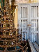 Rusty Weathered Pagoda Spire in Back of Ramshackle house in Burma (Myanmar) Stock Photos