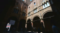 View of famous Torre del Mangia at Palazzo Pubblico in Siena, Tuscany, Italy - stock footage