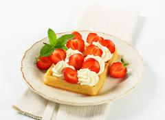 Crisp waffle with  strawberries and cream - stock photo