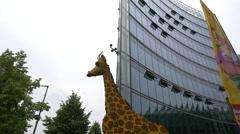 A giant giraffe sculpture in Postdamer Platz Berlin Stock Footage