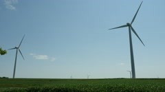 Wind turbine farm in a field Stock Footage