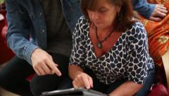 Mother Learns How to Use Tablet Stock Footage