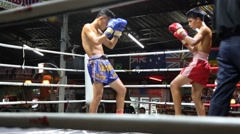 Young male muay thai fighters do push kicks Stock Footage