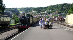 Steam Train 4160 at Minehead station with people on platform Stock Footage