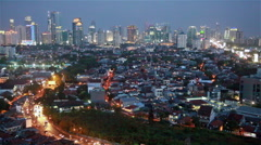 Jakarta traffic and skyline at night Stock Footage