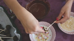 Woman making chocolate cakepops with sprinkles Stock Footage