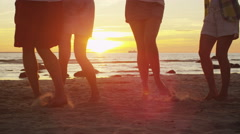 Legs of Happy Young People are Dancing on the Beach in Sunset Light. Slow Motion Stock Footage