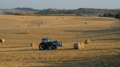 Work on the field in Tuscany, Pienza, Italy. - stock footage