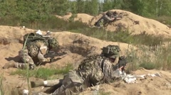 Latvian Army going through a Situational Training Exercise in Saber Strike. - stock footage