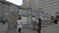 Parts of Berlin Wall and posters in Postdamer Platz Stock Footage