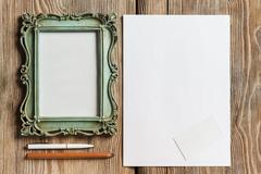The mockup on wooden background with vintage old picture frame Stock Photos