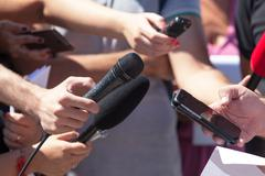 media interview. broadcast journalism. news conference. microphones. - stock photo